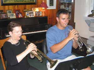 Ms. Craw with trumpet student